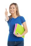 Portrait of woman holding notes showing thumbs up Stock Image