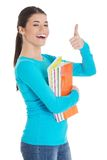 Portrait of woman holding notes showing thumbs up Stock Photo