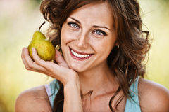 Portrait of woman holding pear Royalty Free Stock Photo