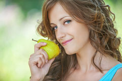 Portrait of woman holding pear Stock Photo