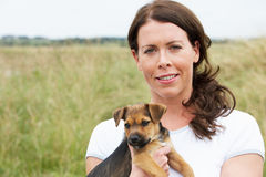 Portrait Of Woman Holding Pet Dog Stock Images