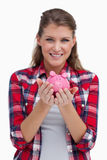 Portrait of a woman holding a piggy bank Royalty Free Stock Image