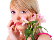 Portrait of a woman holding pink flowers Royalty Free Stock Photos