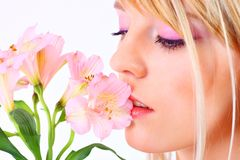 Portrait of a woman holding pink flowers Stock Image