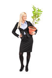 Portrait of a woman holding a pot with plant Royalty Free Stock Photos