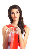 Portrait of a woman holding a red shopping bag Stock Image