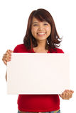 Portrait of a woman holding a sign Stock Photos