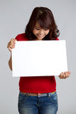 Portrait of a woman holding a sign Stock Photo