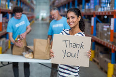 Portrait of woman holding sign boards with thank you message Royalty Free Stock Photo