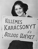 Portrait of woman holding sign written in foreign language Stock Image