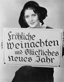 Portrait of woman holding sign written in German Royalty Free Stock Photography