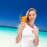 Portrait of woman holding sunscreen cream Royalty Free Stock Image