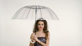 Portrait of woman holding umbrella look at camera stock video footage