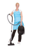 Portrait Of Woman Holding Vacuum Cleaner Royalty Free Stock Photos