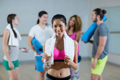 Portrait of woman holding water bottle and towel Stock Images