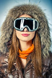 Portrait of a woman in the hood. Snowboarder woman wearing a hood and mask Royalty Free Stock Photography