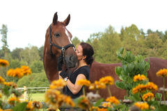 Portrait of woman with horse in flowers Royalty Free Stock Photo