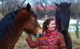 Portrait woman and horse in outdoor. Woman hugging Royalty Free Stock Photo