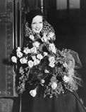 Portrait of woman with huge bouquet. (All persons depicted are no longer living and no estate exists. Supplier grants that there will be no model release issues Royalty Free Stock Image