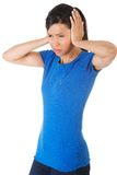 Portrait of a woman with huge headache Royalty Free Stock Image