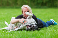 Portrait of a woman hugging her dog Royalty Free Stock Image
