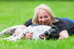 Portrait of a woman hugging her dog Royalty Free Stock Photos