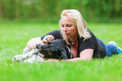 Portrait of a woman hugging her dog Stock Image