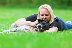 Portrait of a woman hugging her dog Stock Photos