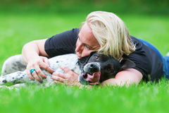 Portrait of a woman hugging her dog Royalty Free Stock Photography