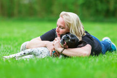 Portrait of a woman hugging her dog Royalty Free Stock Images
