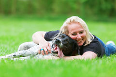 Portrait of a woman hugging her dog Royalty Free Stock Photo