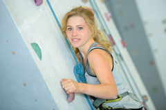 Portrait woman on indoor climbing wall Royalty Free Stock Image