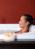 Portrait of woman in jacuzzi stock images