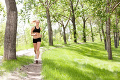 Portrait of woman jogging Stock Photo
