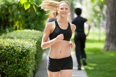 Portrait of a woman jogging Stock Photo