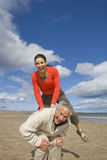 Portrait of woman jumping over man's back. Portrait of women jumping over man's back Stock Images