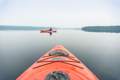 Portrait of woman in kayak taken from the other one Stock Photos