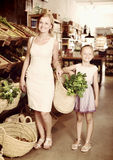 Portrait of woman and kid buying greens Stock Image