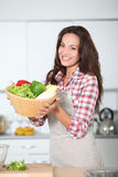 Portrait of woman in kitchen Royalty Free Stock Images