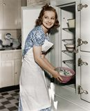 Portrait of woman in kitchen Stock Image