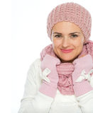 Portrait of woman in knit scarf, hat and mittens Royalty Free Stock Images