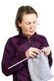 Portrait of woman knitting Royalty Free Stock Images