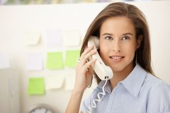 Portrait of woman on landline call Stock Photography