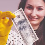 Portrait of woman launder shady money as symbol of illegal cash and corruption. Selective focus on money.  stock photo