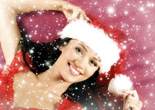 Portrait of a woman laying in a Christmas hat Royalty Free Stock Photography