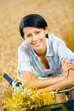 Portrait of woman leaning on bicycle Stock Photography