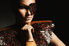 Portrait of woman in leather eyepatch. In dark Stock Photography