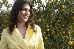 Portrait of Woman in Lemon Grove Royalty Free Stock Photography
