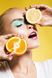 Portrait of woman with lemon and orange Royalty Free Stock Photo