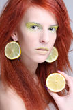 Portrait of woman with lemon slices in ears Royalty Free Stock Photography